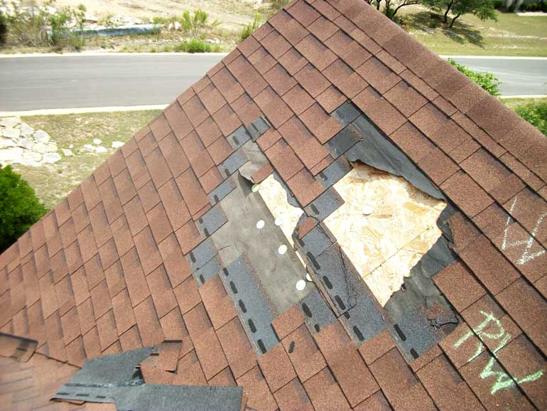 Close up of old, damaged, and in need of repair roof.